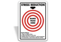 Funny Stress Reduction sign reading bang head here.