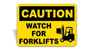 A yellow and black caution watch for forklifts sign