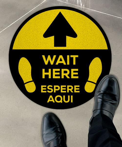 Bilingual Wait Here Floor Sign