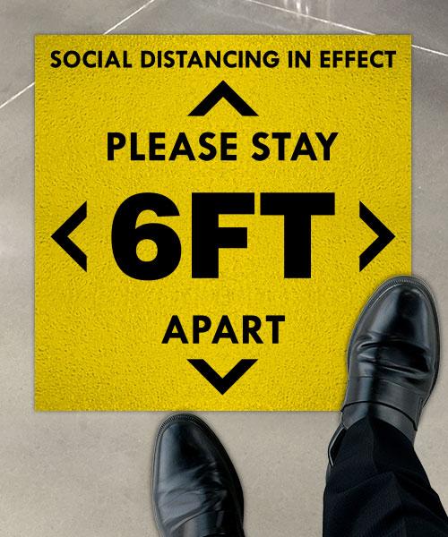 Social Distancing in Effect Floor Sign