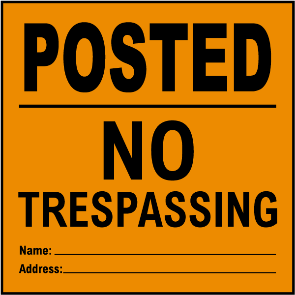 Orange Posted No Trespassing Sign