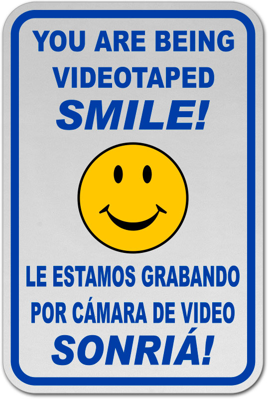 Bilingual You Are Being Videotaped Smile Sign