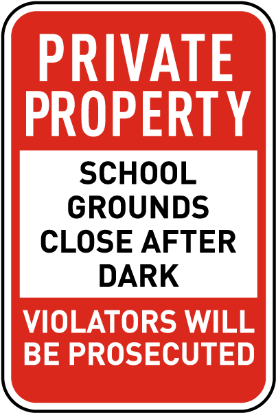 School Grounds Close After Dark Sign
