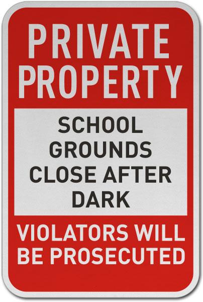 School Grounds Close After Dark Sign