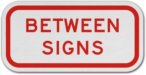 Between Signs Sign