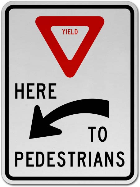 Yield Here to Pedestrians Sign