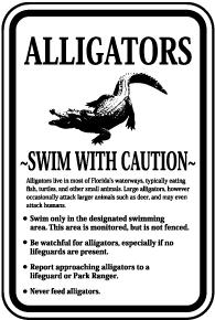 Alligators Swim With Caution Sign
