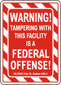 Warning Tampering Facility Is A Federal Offense Sign