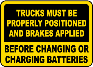 Trucks Must Be Properly Positioned And Brakes Applied Before Changing Or Charging Batteries sign