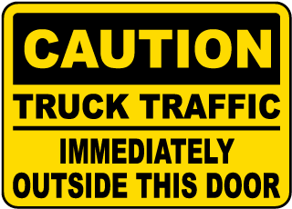 Caution Truck Traffic Immediately Outside This Door Sign