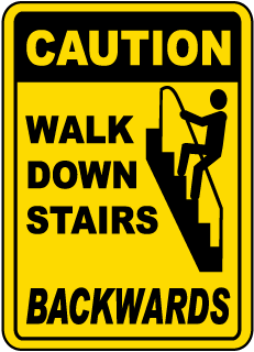 Caution Walk Down Stairs Backwards Sign