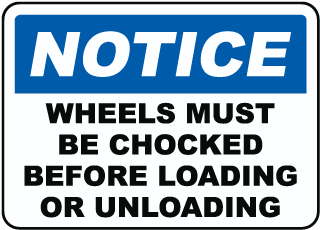 Notice Wheels Must Be Chocked Before Loading Or Unloading Sign