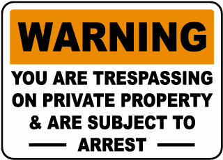 Warning You Are Trespassing On Private Property and Are Subject To Arrest Sign