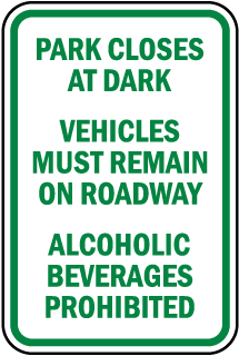 Park Closes At Dark Vehicles Must Remain On Roadway sign
