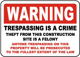 Warning Trespassing is a crime theft from this construction site is a felony...Sign