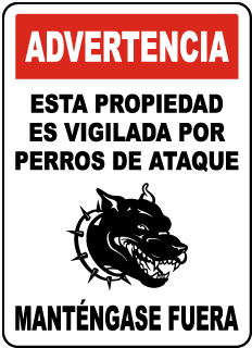 Spanish Property Guarded By Attack Dogs Sign