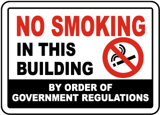 No Smoking In This Building By Order of Government Regulations Sign