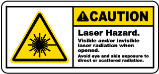 Caution Laser Hazard. Visible and/or invisible laser radiation when opened.. Label