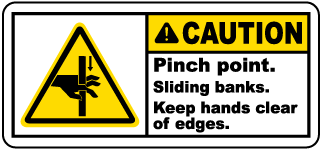 Caution Pinch point Sliding banks Keep hands clear of edges label