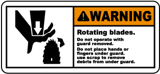 Warning Rotating blades Do not operate with guard removed.. label