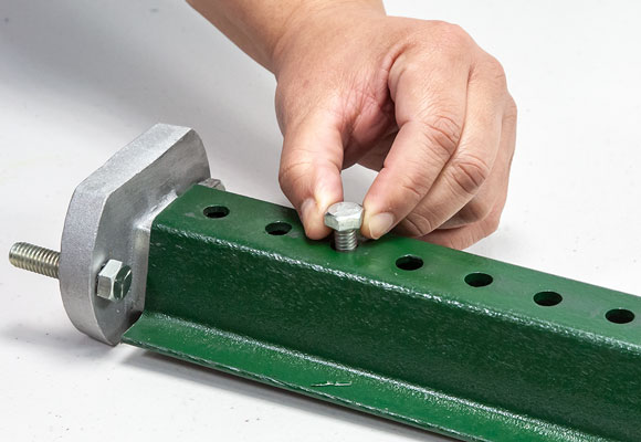 Use the smaller bolting set (2) provided, to attach the adapter to the post