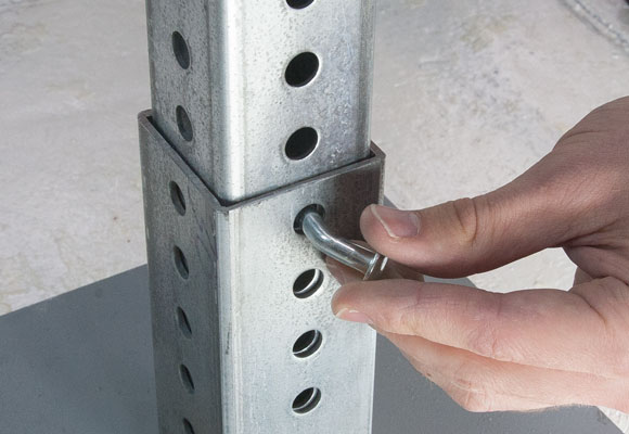Image showing placement of corner bolt into posts