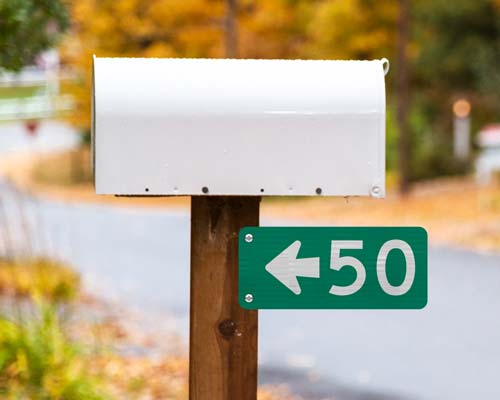 911 Address Signs with Directional arrow pointing towards the house