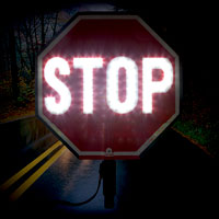 Night time hand held stop sign