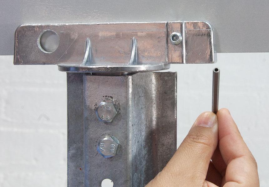 Step 2 of the installation of vandal resistant set screws on street name brackets