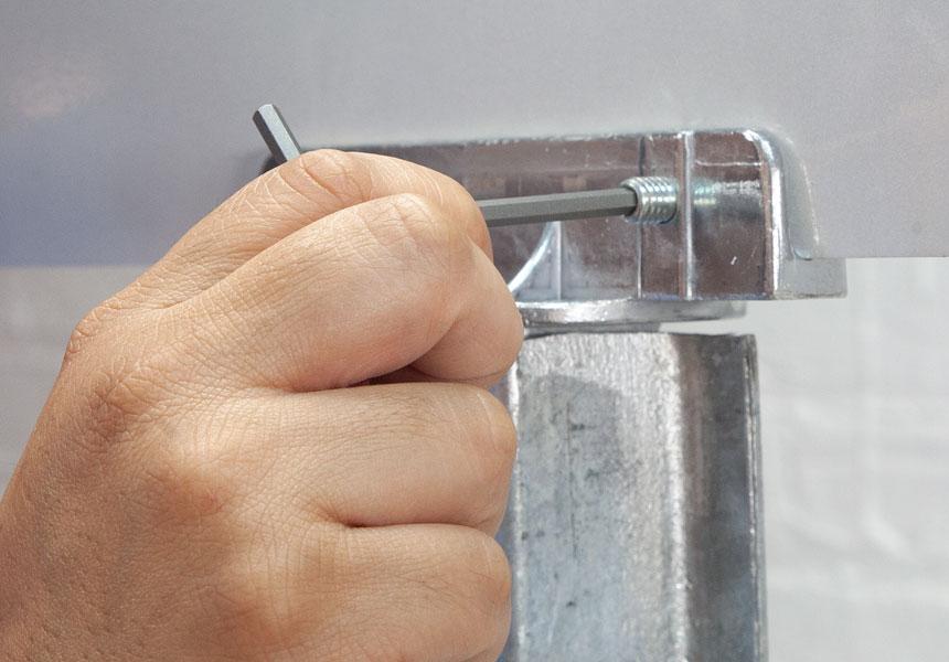 Step 3 of the installation of tamper resistant hex set screws on street brackets