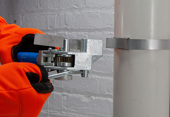 Using either the Spinner or Ratchet tool cut the excess strapping