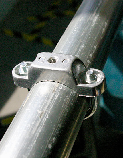 Round post clamp being mounted on round post