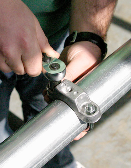 Tightening round post clamp with socket wrench